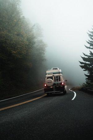 Class B RV on a misty road